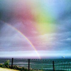 Rainbow over Gyllyngvase beach, Falmouth Cornwall
