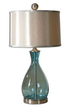 Free shipping and returns on Uttermost 'Meena' Blue Blown Glass Table Lamp at Nordstrom.com. Blown glass in a lovely aquatic blue hue is topped with a lustrous drum shade and a polished, silvery finial on this gorgeous table lamp that will add an eye-catching highlight to your décor.