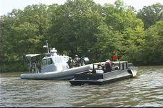 Riverine forces intercept suspicious vessel during training event.