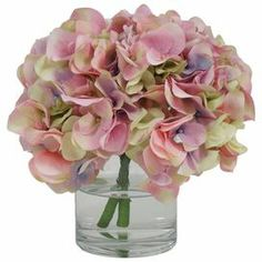 "Create a lush tablescape or charming vignette with this lovely faux pink-hued hydrangea arrangement in a glass vase.   Product: Faux floral arrangementConstruction Material: Silk and glassColor: PinkFeatures: Includes faux hydrangeaDimensions: 10"" H x 11"" Diameter"