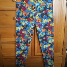 LuLaRoe TC Leggings. Multi-colored Palm Trees. NWT. Never worn, washed, or tried on. LuLaRoe TC Leggings. Medium blue (lighter than royal or navy blue, but darker than light blue - I apologize, I really don't know my blues. The blue in the second picture it's very accurate though.) background with multi-colored palm trees. Beautiful design. All original prices are what I paid with shipping. LuLaRoe Pants Leggings