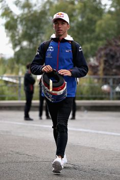 Pierre Gasly of France and Scuderia Toro Rosso walks in the Paddock before practice for the Formula One Grand Prix of Belgium at Circuit de Spa-Francorchamps on August 2018 in Spa, Belgium. Get premium, high resolution news photos at Getty Images Daniel Ricciardo, F1 Drivers, F1 Racing, F 1, Formula One, Fanfiction, Pilot, French Baguette, Handsome
