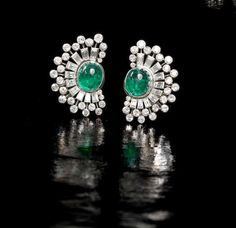 A pair of emerald and diamond earclips,