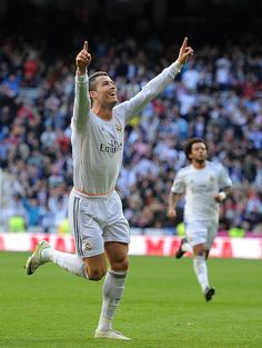 Cristiano Ronaldo celebrates after scoring his team's first goal during the La Liga match between Real Madrid CF and Granada CF at Estadio Santiago Bernabéu on January 25, 2014 in Madrid, Spain.