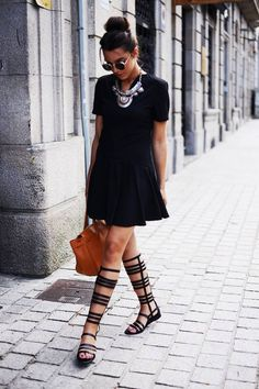 Black gladiator sandals with black summer dress