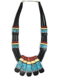 We feature Santo Domingo mosaic inlay with jet heishi ceremonial necklaces by Torevia Crespin! Enjoy a large selection of beautiful, authentic Native American necklaces and Santo Domingo Indian jewelry to choose from at Southwest Silver Gallery!