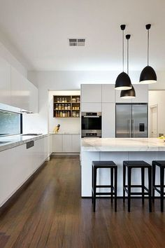 white kitchen with bell shape shade in matte black made of carbon steel. White kitchens are able to transform a home. If you want a cozy vintage or scandinavian kitchen, you need to use white in your modern kitchen ideas. See more home design ideas at http://www.homedesignideas.eu/10-amazing-design-ideas-for-your-modern-home-white-kitchens/