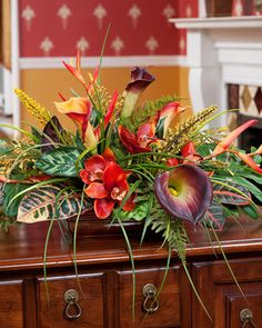 Tropical orchid, calla lily and croton leaves low centerpiece silk flower arrangement Tropical Flowers, Tropical Flower Arrangements, Artificial Floral Arrangements, Artificial Orchids, Silk Floral Arrangements, Tropical Colors, Tropical Decor, Faux Flowers, Silk Flowers