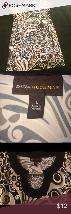 Dana Buchman dress sz L Fun dress with a retro feel. Colors are brown, tan, black,and white. So pretty and comfortable. Metal adornment at neckline. Worn twice. No pulls, snags, pilling. Smoke free home. EUC Dana Buchman Dresses