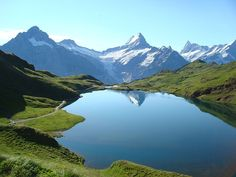 Photograph by Ryan Gsell   Bachalpsee or Bachse is a lake with an area of 8.06 ha (19.9 acres) close to the First (a minor summit below the Schwarzhorn which can be reached with a cable car) and above Grindelwald in the Bernese Oberland (Bernese highlands) of Switzerland.