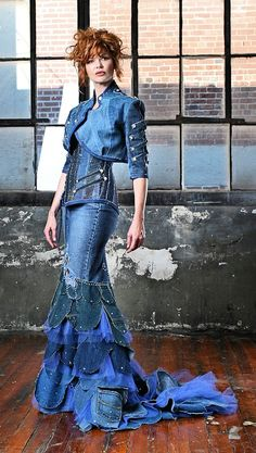 "I think that we can all agree that denim is a 'no-no"" for a formal affair (and denim on denim is never okay); however, I must give props to whomever made this gown, the detail (especially in the fishtail area) is quite extraordinary.  If your prom dress is sponsored by Wrangler Jeans, you might regret it."