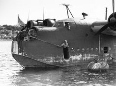Short Sunderland Royal Australian Air Force Sunderland RAAF close-up at Sydney, Australia while being anchored. The nose turret could be retracted to make room for an anchor place.