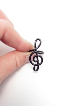 Treble clef ring in wire wrapped aluminium adjustable by alufolie, $9.00