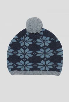 Tearoom Hat | Classic bobble hat in soft lambswool and a quirky snowflake knit. In a versatile colour, with contrast rib knit hem and big cheery bobble.