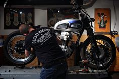 How to buy a motorcycle for your custom project: A scene from the Revival Cycles workshop, with a vintage Triumph. (Good to see revival supporting other shops via their t-shirts too!)