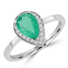 Add some color to your night with Majesty Diamonds'  1/2 CTW Pear Cut Emerald and Diamond Halo Fashion Cocktail Ring in 14K White Gold. #emerald #cocktail #ring