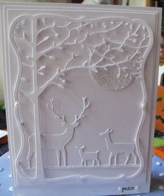 White on White Embossed Forest...with tree & deer.