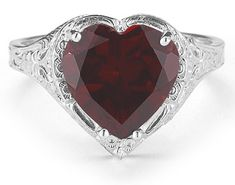 applesofgold.com - Love has a whimsical new look in this elegantly crafted garnet ring, brought to you by Apples of Gold. The single but stunning garnet stone features a deep scarlet color and is cut into a heart shape for the sweetest style. The stone is held in place by four prongs and given a gorgeous band of 14K white gold for its base. This clean white gold setting shows off various filigree elements that harken back to the Victorian age when romance reigned. $489