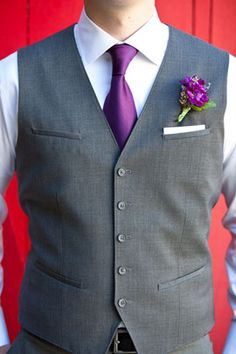 That's what my boys will be wearing only with navy ties and coral flower  So cool. Great for purple weddings