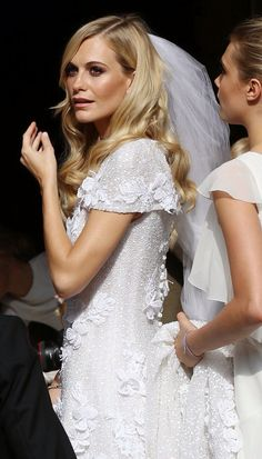 Poppy Delevinge in Chanel wedding dress XX
