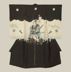 A boy's plain silk miyamairi kimono created for a ceremonial Shinto shrine blessing. The main motif is the legendary young samurai Momotaro, accomplished with intricate yuzen-dyeing, painted highlights, plain and sagara embroidery.  Meiji period (1867-1911), Japan.  The Kimono Gallery
