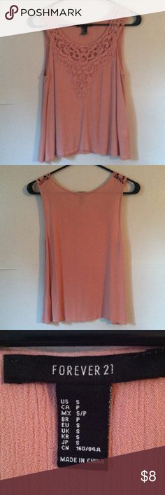 Forever 21 sleeveless shirt top Small •Excellent used condition •Worn handful of times •Lace design on the upper front chest and shoulder portion •Sleeveless •Color: Pink •Brand: Forever 21 •Size: Small •NO TRADES Forever 21 Tops