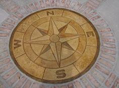 Stamped Concrete Compass (compass acid stained) by Rock Solid Custom Concrete, Wilmington, NC  www.rocksolidcustomconcrete.biz