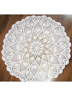 """Graceful pineapples change size and flow into each other as the doily blooms into its full size. Doily measures 29"""" in diameter and uses size 10 crochet cotton.Also includes instructions for smaller doily designs by simply fastening off after s..."""