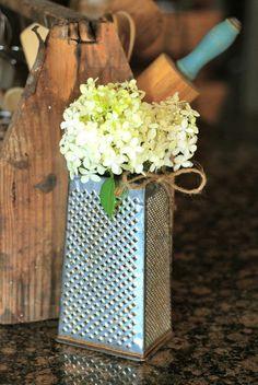 old grater as a vase for flowers   .... put a bottle inside