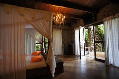 Master Suite, Ethiopia - Beautiful master suite in Kuriftu, Lake Tana, Ethiopia. The chandelier and soft white linen brings a romantic feel to the rustic room.  #Mastersuite #Bedroom