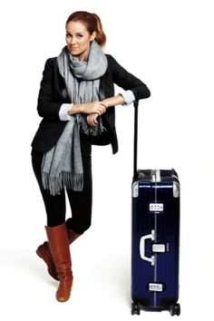 love the layering on this outfit. So smart to wear a big item like boots instead of packing them in that little suitcase!