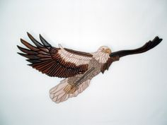 Eagle, Wood Sculpture, Wall Decor. by GalleryatKingston . This beautiful eagle is 244 pieces of wood. The process is called Intarsia. #zibbet