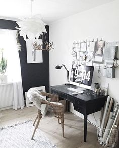 Nordic workspace with black feature wall + grid board