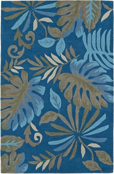 Create a retreat feel right in your own living room with this colorful Tropical Garden Inspired Rug in rich island colors and images on a bright blue background.
