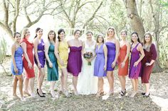 MULTI-COLORED BRIDESMAIDS IN DRESSES THEY CAN WEAR AGAIN W/NO PROBLEM!  LOOKS SO PRETTY ALL THE DIFFERENT COLORS!!