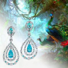 """David Morris Jeweller. A beautiful pair of """"neon"""" coloured Paraiba Tourmaline drop earrings, surrounded by marquise white diamonds."""