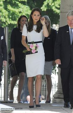 Crepe dress with navy trim dress by Jaeger, Russell and Bromley Muse clutch, Cartier watch, McQueen blue suede pumps