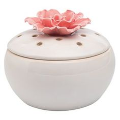 In Bloom.   This elegant white porcelain element warmer holds Scentsy cubes under the blossom, the beautiful scent emerging from a scattering of openings. This lovely element warmer does its work without a light, a nice touch when discretion is valued. Great in the master bedroom, your home office or the guest bath. Pair with the Scent for April, 2015, Spring Symphony, for a floral fantasy.