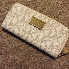 Authentic Michael Kors MK Wallet (Beige) Cute MK wallet. Small scratch on face plate (view picture). Michael Kors Bags Wallets