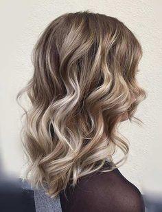 Curly Long Bob Haircut with Blonde Balayage Highlights
