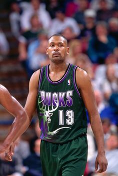 SACRAMENTO, CA - 1996: Glenn Robinson #13 of the Milwaukee Bucks gets into position against the Sacramento Kings during a game played on March 13, 1996 at Arco Arena in Sacramento, California.