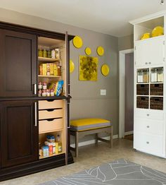 Repurposed Armoire Pantry  An inexpensive armoire serves as a pantry unit in this small kitchen. New built-in shelves and drawers add to the functionality inside of the pantry, and its exterior was stained a darker color for a more expensive look.