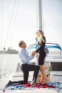 perfect proposal - on a boat with our families  friends ready to celebrate - someone please tell my future fiancé