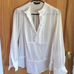 BCBG White Blouse BCBG MaxAzria white blouse! It's so pretty and comfortable, and perfect for spring weather. It is gently used with some slight discoloration (see picture 4). Some wrinkles. Make an offer!  BCBGMaxAzria Tops Blouses