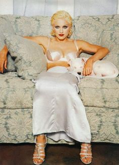Madonna and her pet bull Pepito in Miami 1994. Some of these shots  were published in the Bedtime Stories insert. Photo by Patrick Demarchelier.