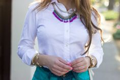 purple and gold statement necklace with white collar detail