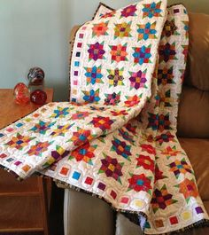 Looking for your next project? You're going to love Flowers Squared Quilt #528 by designer Paulette Mo. - via @Craftsy