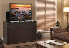 Check out the Ellis Trunk TV Lift Cabinet available online at Sharper Image!