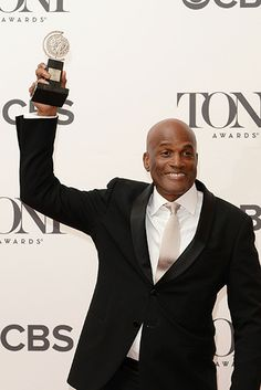 Kenny Leon, winner of the Tony Award for Best Direction of a Play for 'A Raisin in the Sun', poses in The Paramount Hotel Winners Circle Lounge during the 2014 Tony Awards.  Credit: Andrew H. Walker/Getty Images