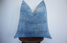 Super soft and faded vintage African Mudcloth Indigo pillow cover. This gorgeous fabric is a handwoven textile of natural cotton made in Africa. Fabric sourced from Burkina Faso, custom made in the USA by One Affirmation with love. Size: 22 x 22  Front: 100% Cotton Reverse side: 100% European Linen in cream **Insert not included - This pillow photographed here with with a 20x20 feather down insert.  Dry clean or spot clean only - the vintage fabric has been laundered and the linen is brand…